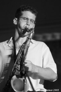 black and white photo of David Sills playing saxophone at The Bakery of Culver City in 2001